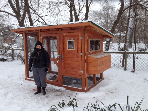 Jilli in front of the recently completed chicken coop.