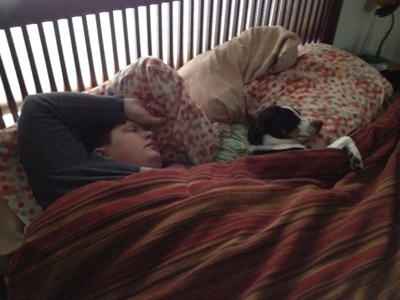 Charlie and Jilli all snuggled in bed.